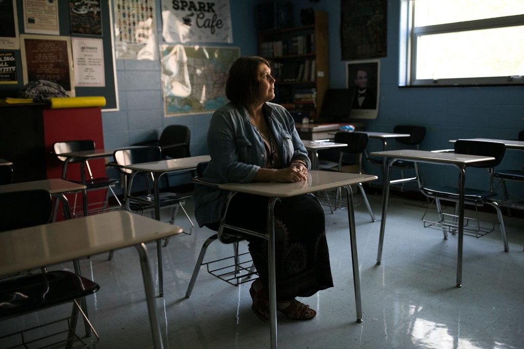 Hope Brown sits in a classroom at Woodford County High School in Versailles, KY on August 31, 2018. Brown works full time as a teacher, and has also taken on part time jobs as well as selling her plasma to pay the bills.